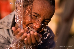 Smiling boy drinking clean water