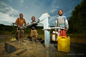 Kids operating a water pump